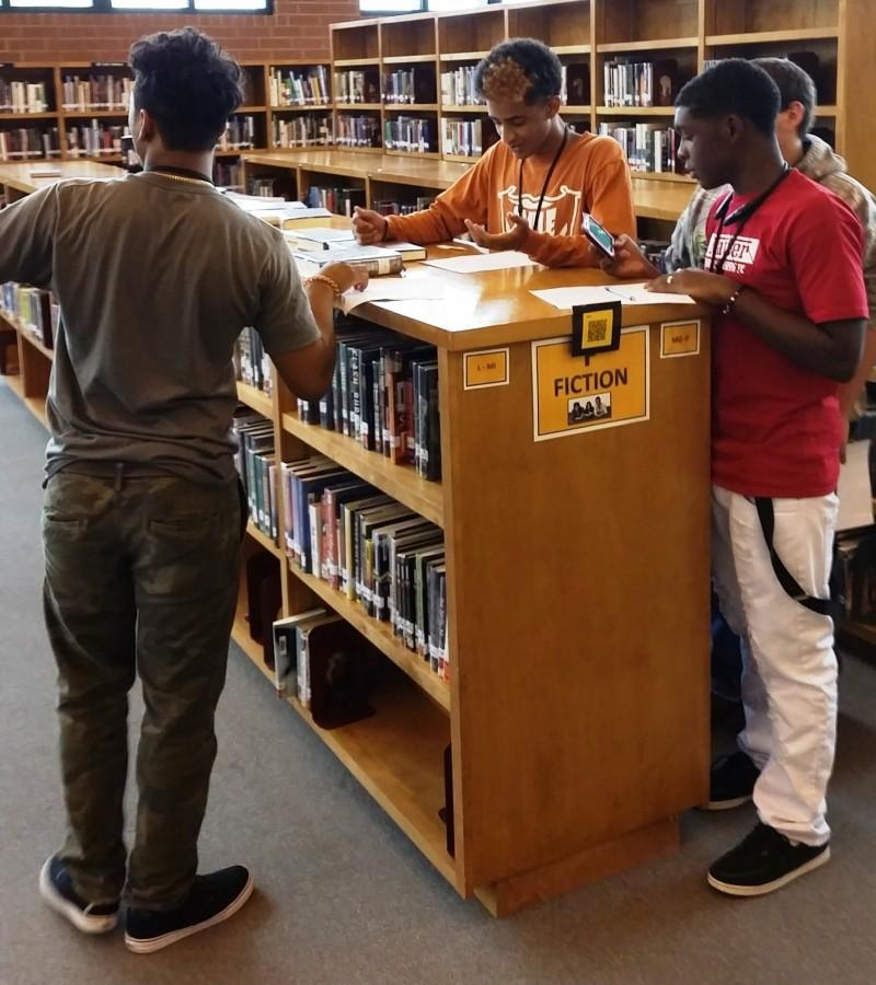 Freshmen+students+use+their+%22QR%22+readers+from+their+electronic+devices+to+find+information+during+a+Media+Center+scavenger+hunt+Thursday.+Students+learned+information+about+the+library%27s+resources+during+the+lesson.