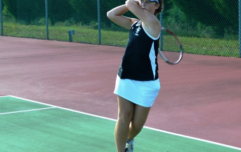 Yellow Jackets 'Swat' Emerald in Girl's Tennis Action