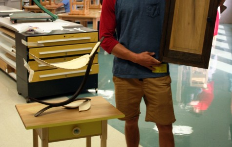 Greer High School graduate Chaz Bregg takes a moment to show off his furniture that he has made. Bregg, a 2013 graduate of Greer High School, spoke to Allison Duncan's art class. Bregg attends the Savannah College of Art and Design (SCAD).