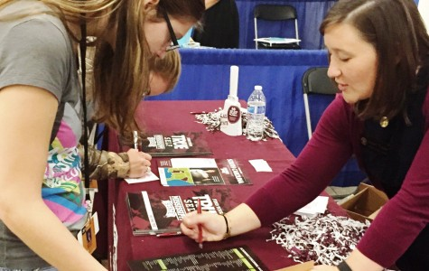A Greer High School student obtains information from a member from the University of South Carolina Admissions Department. Juniors and Seniors from Greer High School, as well as students from Greenville County, attended the annual College Fair at the TD Center on Tuesday.