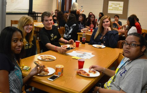Members of the Book Club at Greer High School meet during Third Lunch to enjoy a snack while learning about the books they get to read this year.