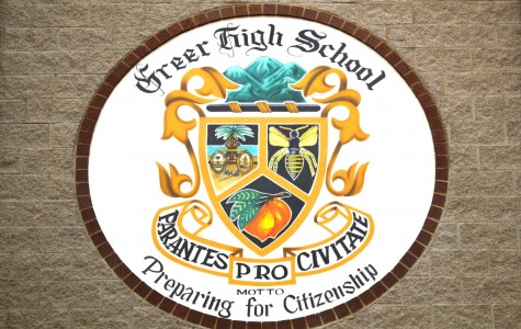 The Greer High School's Seal and Crest can be found in the school's Atrium when walking into the main entrance. The Seal is just one of the many examples of tradition that can be found at Greer High School.
