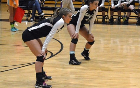 Members of the Greer High School Volleyball Team await a serve from the opposing team. The Yellow Jackets swept past Chapman High School, 3-0, Tuesday night at Chapman High School.