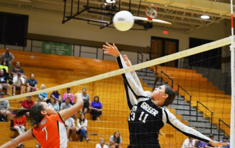 Members of the Greer High School tip the ball against a Southside High School player. The Yellow Jackets swept the Tigers, 3-0, Thursday night at Greer High School.