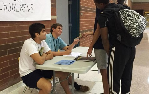 Members of the Le Flambeau Yearbook Staff sell yearbooks to students during the Yearbook Blitz on Friday. Students were able to buy their yearbooks early and save $5.