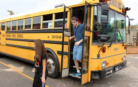 Greer High School students exit a bus during the South Carolina State Mandated Bus Evacuation Drill on Wednesday.