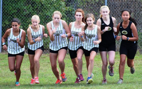 Members of the Greer High School Girl's Cross Country Team begin their race Wednesday night in a meet at Blue Ridge High School. The Yellow Jackets finished fourth place at the meet.