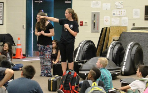 Greer High School Senior Drum Major Elizabeth Schneider and Senior Band Captain Brittany Stewart address members of the Greer Middle School Band Friday night before the Yellow Jackets' home game against Emerald High School at Dooley Field.