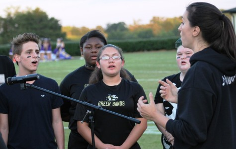 Members of the Greer High School Choirs perform the school's alma mater under the direction of Sarah Hargett Friday night before the Yellow Jackets' home football game against Emerald High School at Dooley Field.