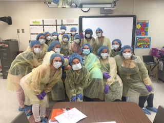 Students from the Health Science class learn what protective equipment to wear during a procedure in the Health Care field.