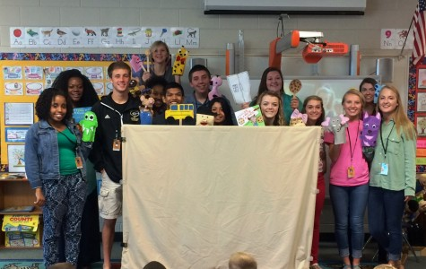 Members of the Greer High School Teacher Cadet Class show off their puppets they made for a local elementary school class.