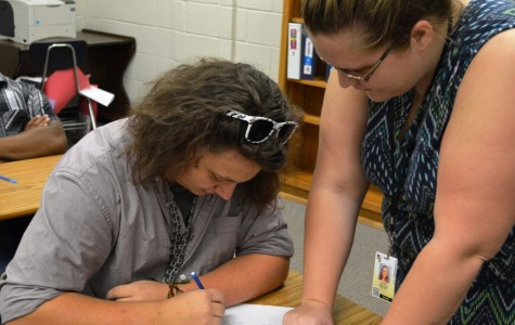 Greer High School new mathematics teacher Sara Beth Snyder assists one of her students. Snyder comes to Greer from Knoxville, Tennessee, where she taught at Karns High School.