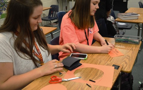 Members of the Greer High School Chapter of Leo Club work on Halloween Cards for the Greenville Children's Hospital.