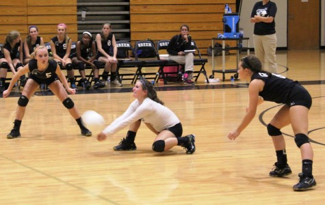 Members of the Greer High School JV Volleyball Team return a serve from Travelers Rest High School Tuesday night at Greer High School. The Yellow Jackets won the match, 2-1.