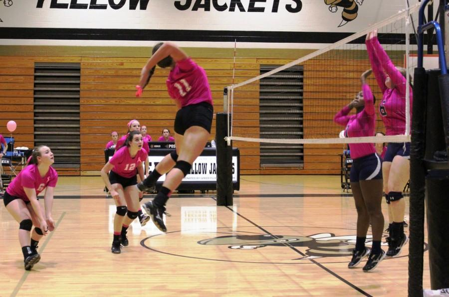 Greer+High+School+Junior+Hitter+Lindsey+Jarecki+prepares+to+spike+the+ball+against+Chapman+High+School.+The+Yellow+Jackets+defeated+the+Panthers%2C+3-0%2C+in+their+annual+%22Pink+Out%22+Match+Thursday+night+at+Greer+High+School.