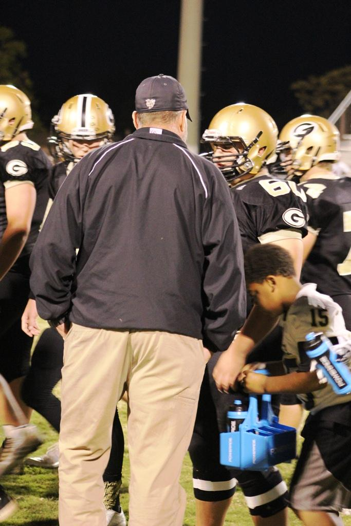 Greer High School Football Coach Will Young speaks with the JV Team during a recent football game. The Yellow Jackets defeated Southside High School, 28-14, Thursday night at Southside High School.