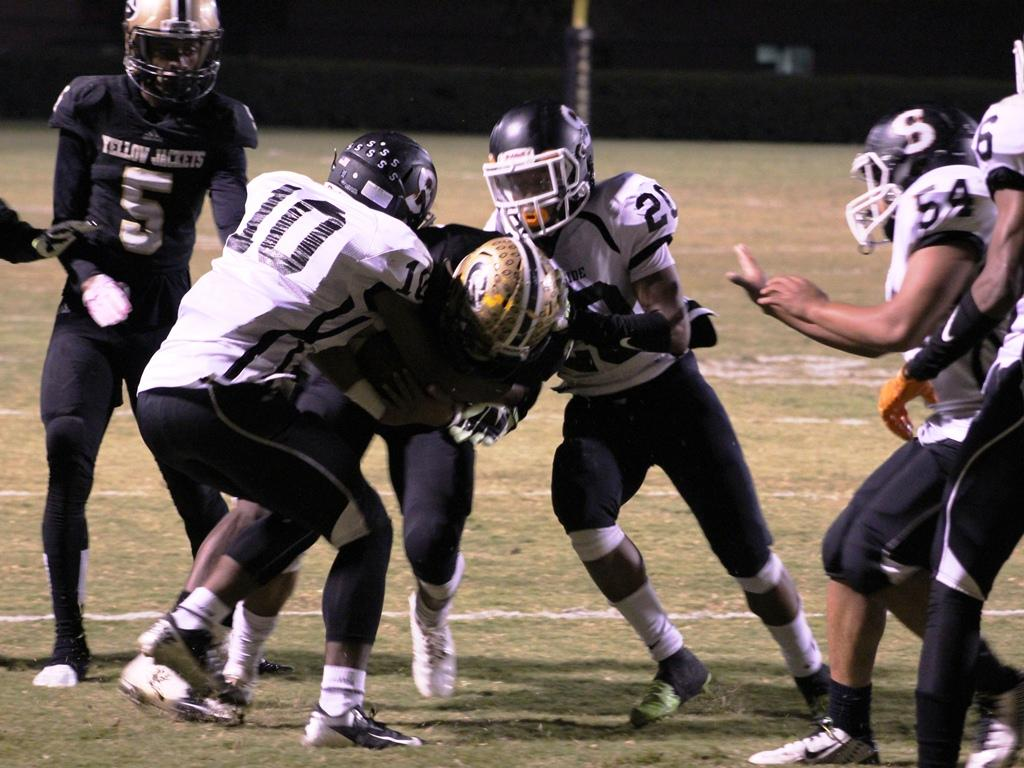 Greer High School Senior Running Back Adrian McGee fights to gain yards in the Yellow Jackets' 48-14 win over Southside High School Friday night at Dooley Field.