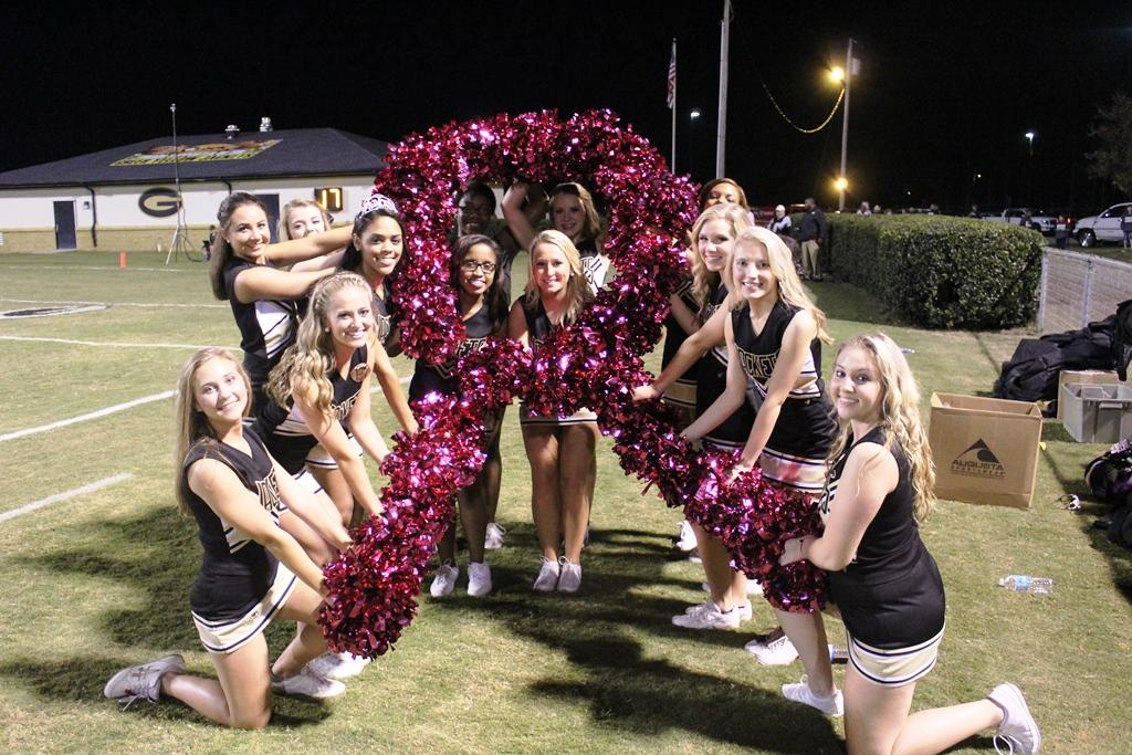 The Greer High School Varsity Cheerleading Squad shows its support for Breast Cancer Awareness during the month of October. The cheerleaders wore pink bows and used pink pom-poms.