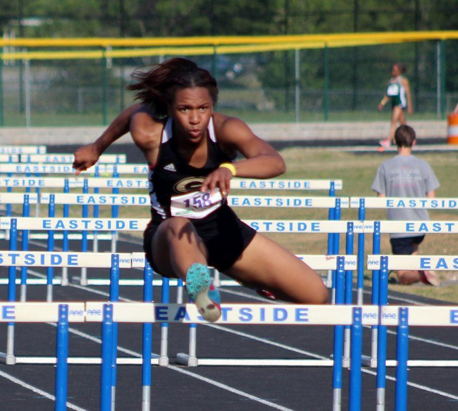 Greer+High+School+Sophomore+Kaiya+Bradford+clears+a+hurdle+to+finish+the+100+Hurdle+event+at+the+Greenville+County+Track+and+Field+Championships+Wednesday+night+at+Eastside+High+School.