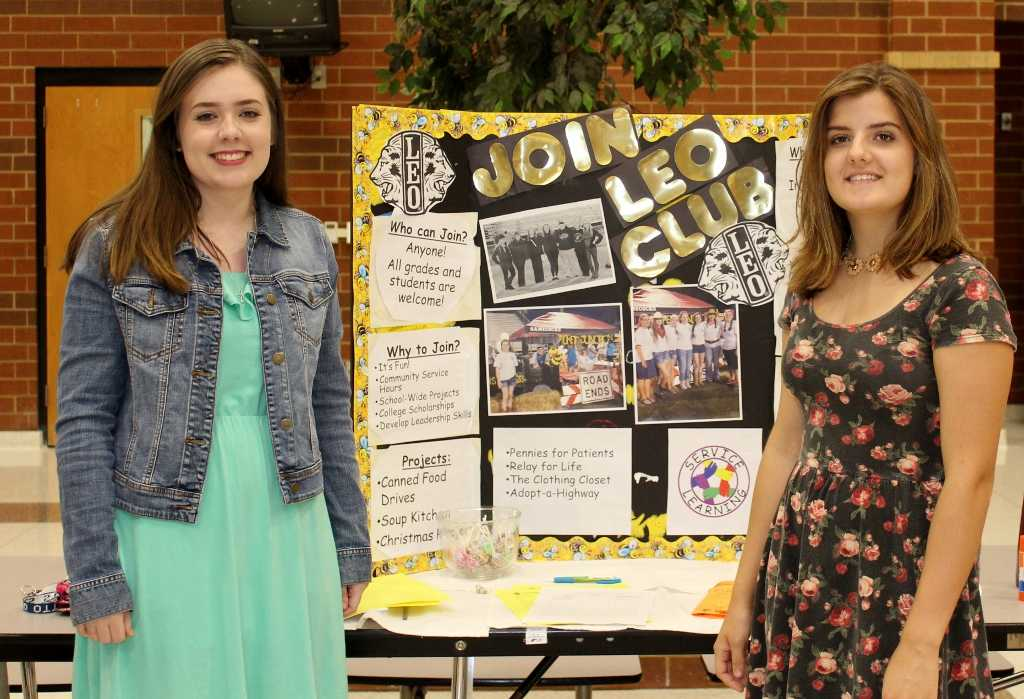 Greer High School Senior Ashley Joins and Junior Victoria Brown speak to the public about the opportunities in the Leo Club Tuesday night during the Open House at Greer High School.