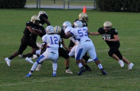 Greer High School Sophomore A.J. Bolden runs the ball in a JV Football game this year.