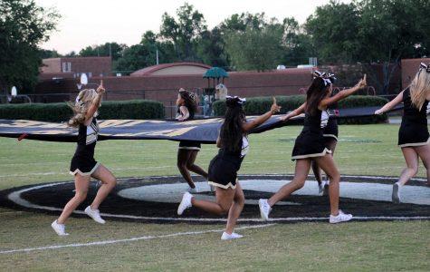 Varsity Cheerleaders Work Tirelessly in Preserving Flag Tradition