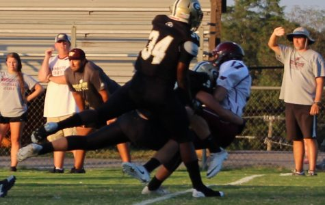 A group of Greer High School JV defenders sack a quarterback in a recent game. The Yellow Jackets routed Travelers Rest High School, 47-0, Thursday night at Travelers Rest High School.