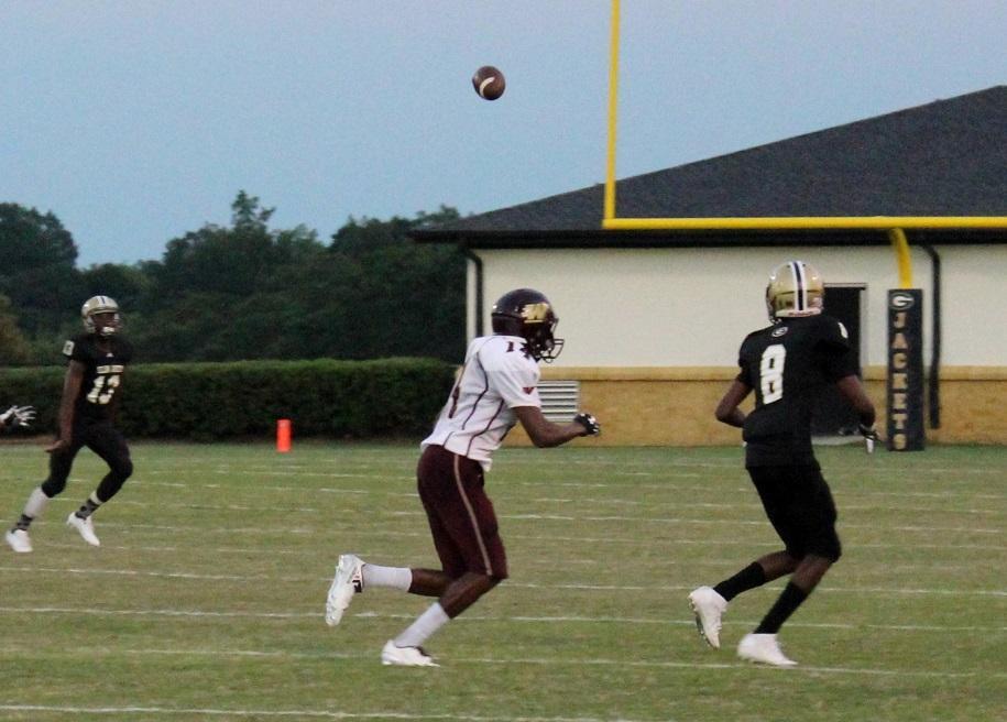Greer High School sophomore Cameron Ferguson prepares to catch a pass from junior Ahmad Mattison Thursday night at Dooley Field.