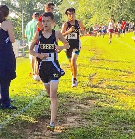 Greer High School Freshman Tyler Jasper strides as he runs a cross country course recently. Jasper finished in 166th place in Saturday's Canned Food Drive 5K at Hillcrest High School.