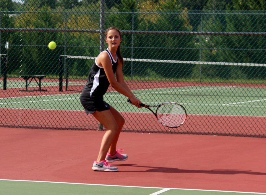 Greer+High+School+Tennis+player+Ella+Kate+Brannon+returns+a+serve+in+the+Yellow+Jackets%27+matchup+against+Powdersville+High+School+Wednesday+night+at+Powdersville+High+School.