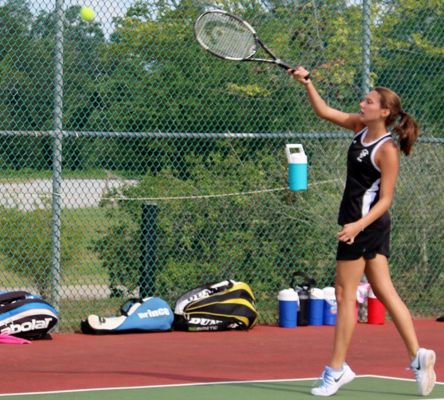 Greer+High+School+Sophomore+Ashley+Barnett+returns+a+serve+during+a+recent+match.+The+Yellow+Jackets+defeated+Eastside+High+School%2C+4-3%2C+Monday+night+at+Eastside+High+School.