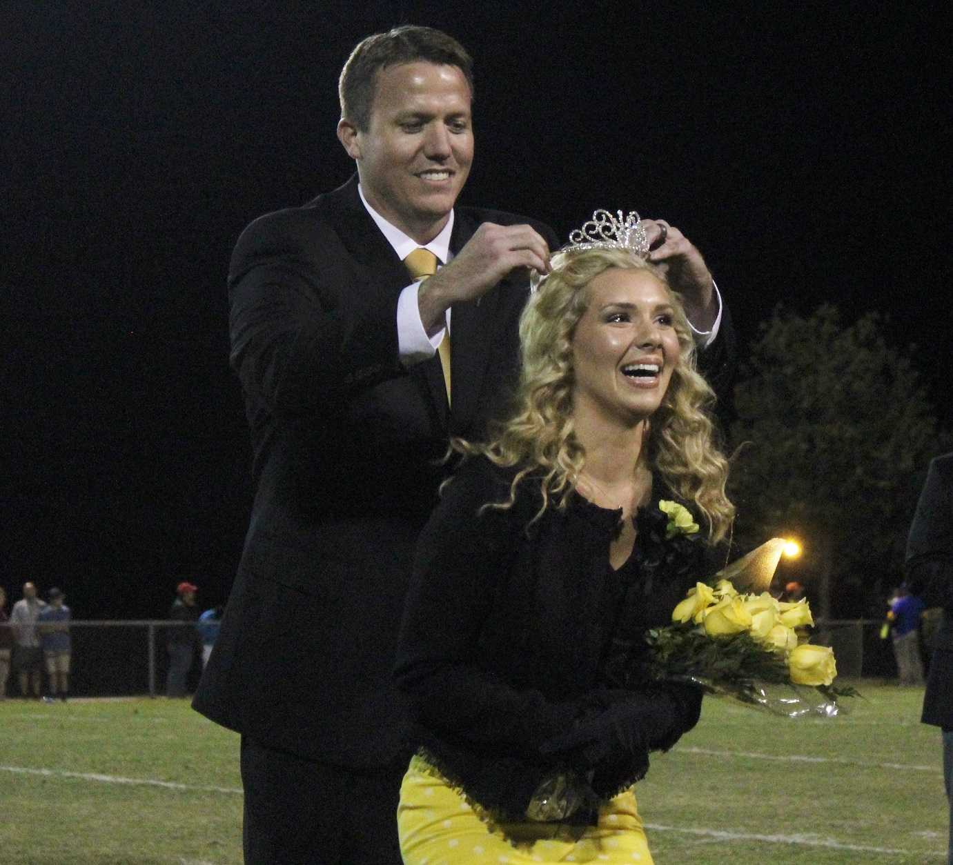 Greer High School Senior Emma Cornell smiles as she is crowned Homecoming Queen Friday night at Halftime of the Yellow Jackets' game against Travelers Rest High School.