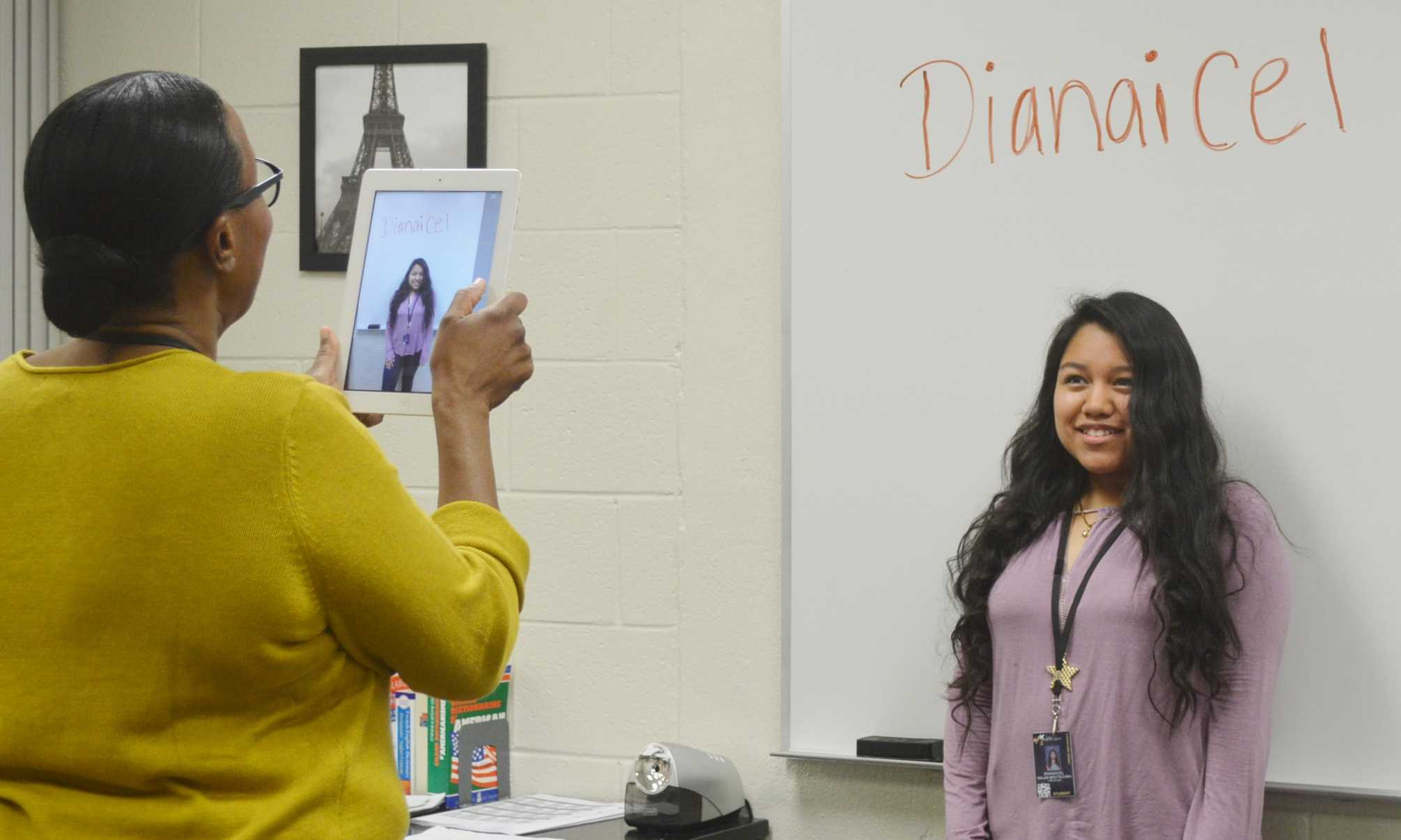 Greer High School French Club Adviser Mona Simon takes the picture of sophomore Dianicel Salas at a French Club Meeting Friday morning.