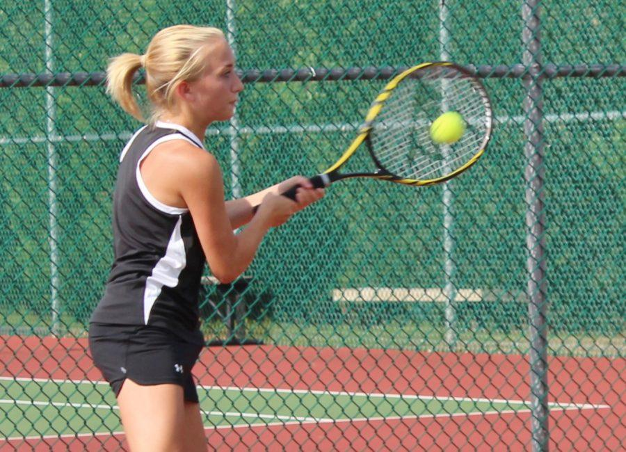 Greer+High+School+Tennis+Player+Emily+Swearingin+returns+a+serve+in+a+match+this+year.+Swearingin+helped+lead+the+Yellow+Jackets+to+a+4-3+victory+over+Powdersville+Thursday+night+at+Greer+High+School.