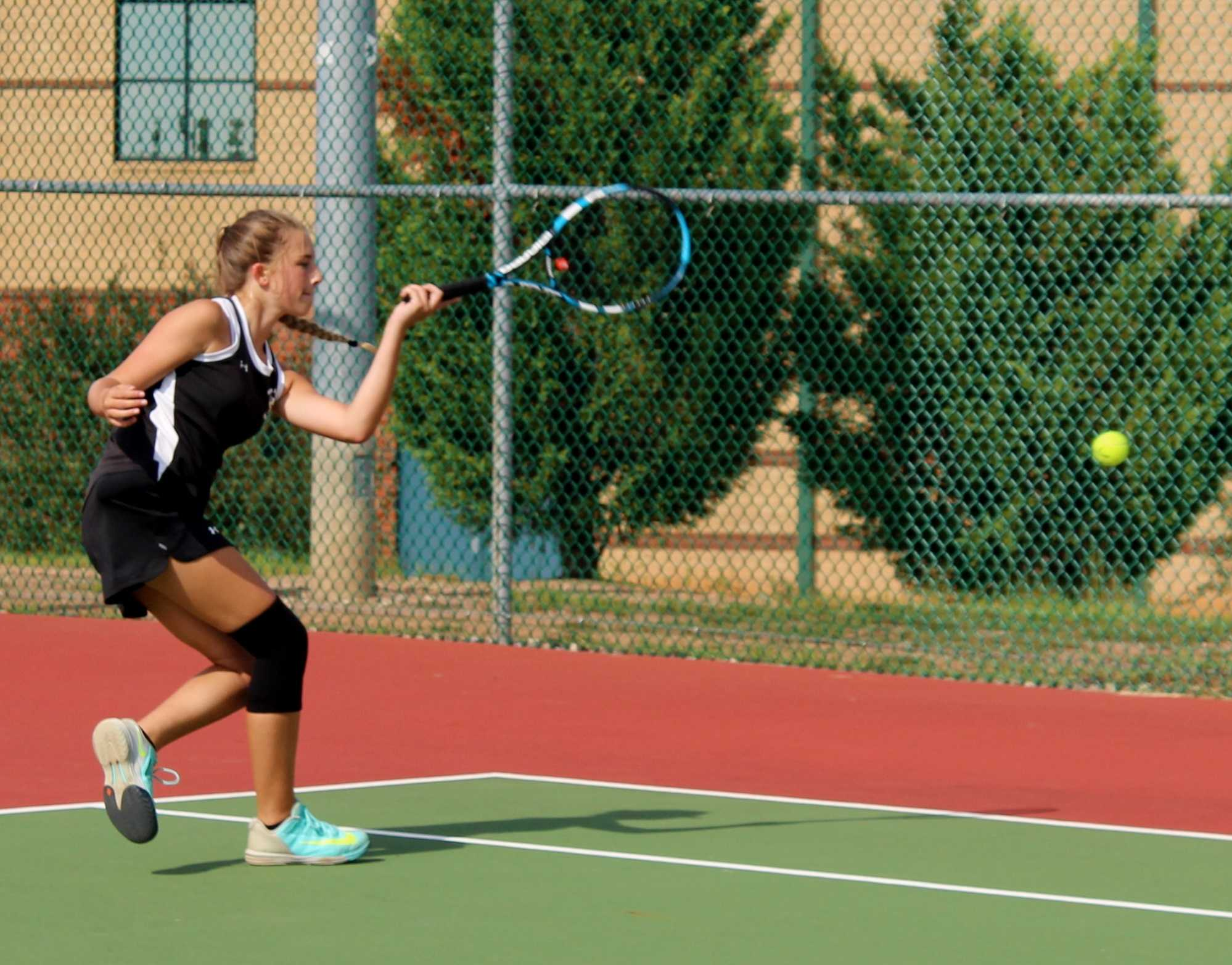 Greer High School sophomore Hannah Henline returns a serve in a recent match. The Yellow Jackets defeated Blue Ridge High School, 6-1, Wednesday in the final match of the regular season.