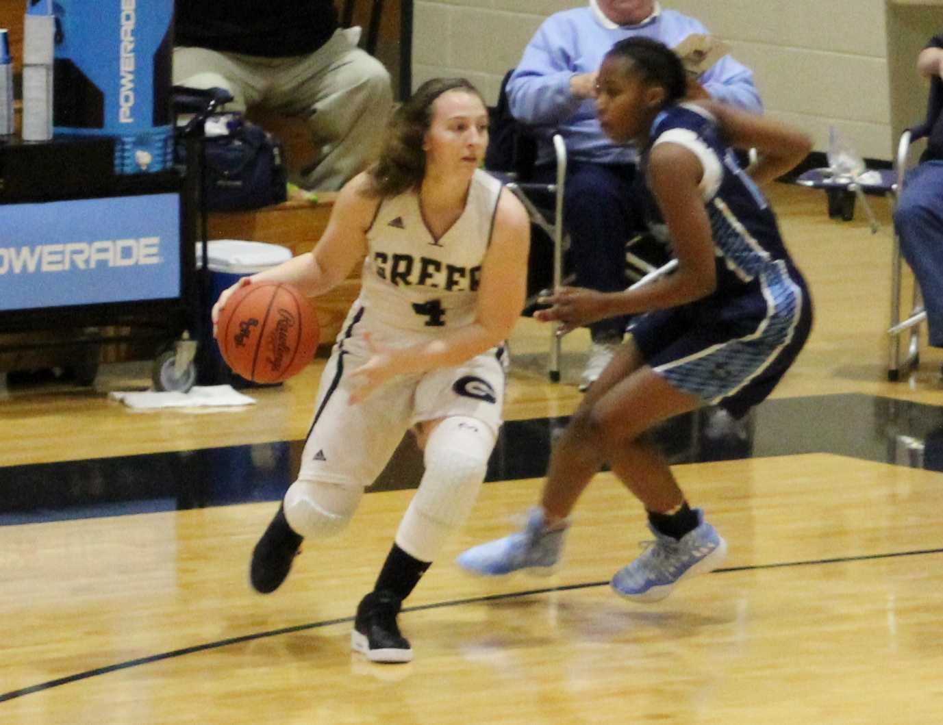 Greer High School sophomore Megan Jones dribbles the ball in the Yellow Jackets' win over Dorman High School Thursday night at Greer High School.
