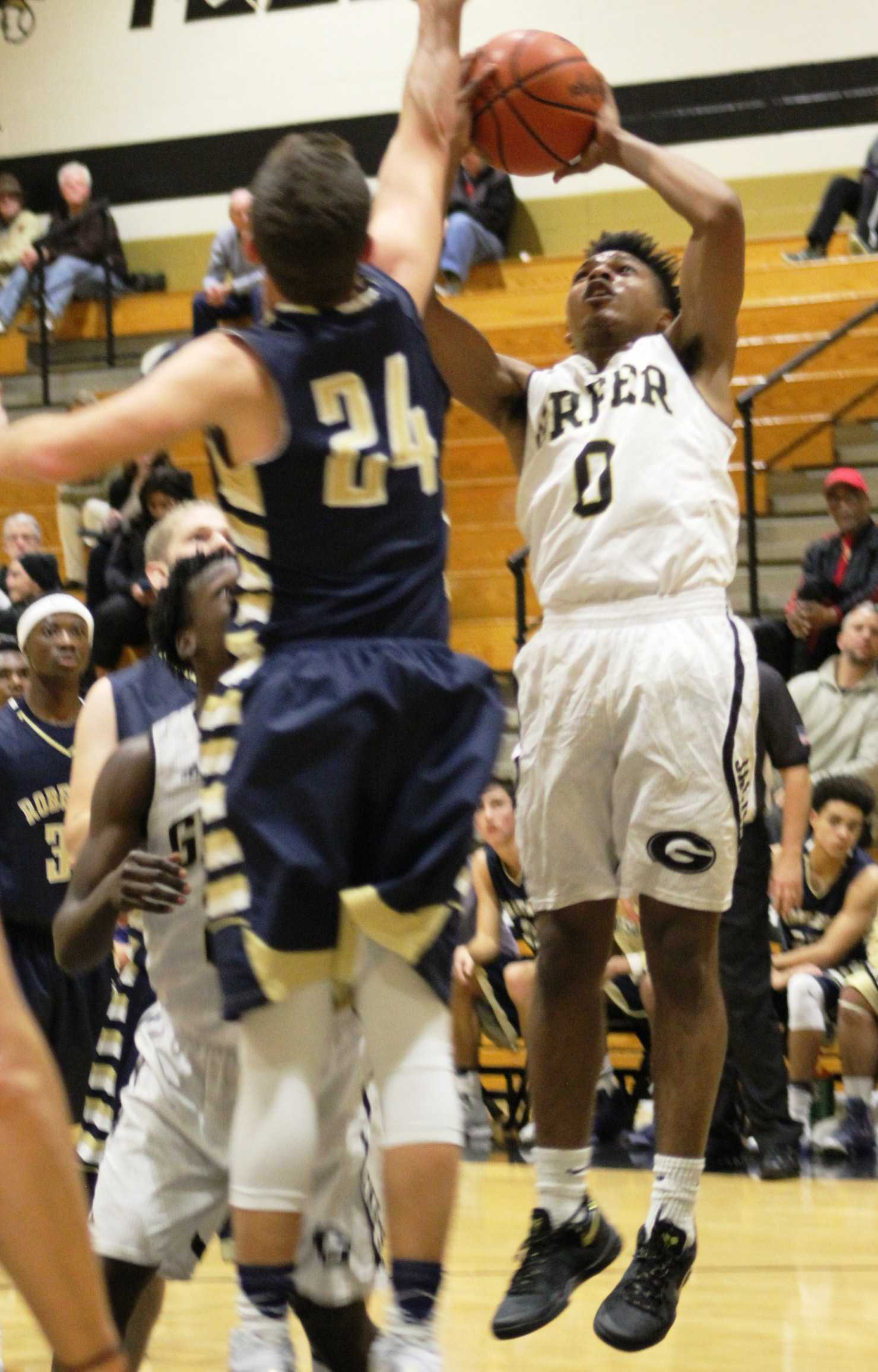 Greer High School sophomore Magic Moody drives to the basket in the Yellow Jackets' 80-56 win over T.C. Roberson High School Thursday night at Greer High School.