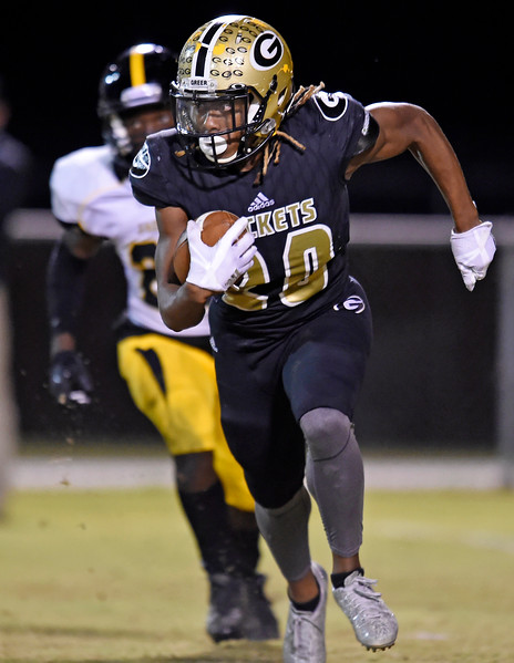 Greer's Quavian White (20) breaks free as Union County's Dee Davis (22) gives chase. The Greer Yellow Jackets played host to the Union County Yellow Jackets in a Class AAAA Region 2 football game. [GWINN DAVIS / for the Spartanburg Herald-Journal]